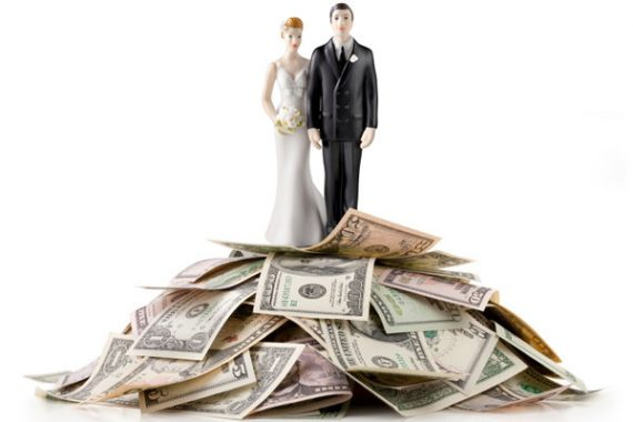 Bride and groom caketopper on money