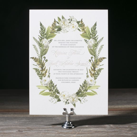 Wedding invitation with bordering leaves in an oval