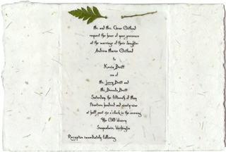Wedding invitation on seeded paper with fern leaf