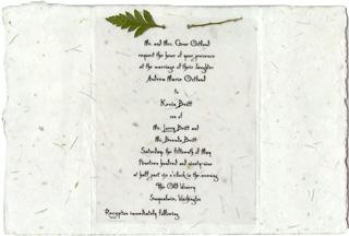 Wedding invitation on seeded paper with fern leaf