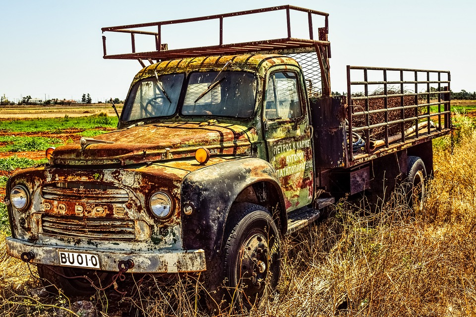 Rusted truck in grass