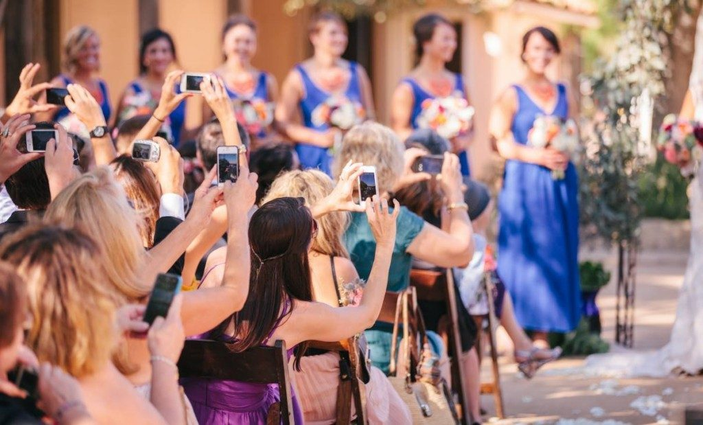Women taking pictures at wedding