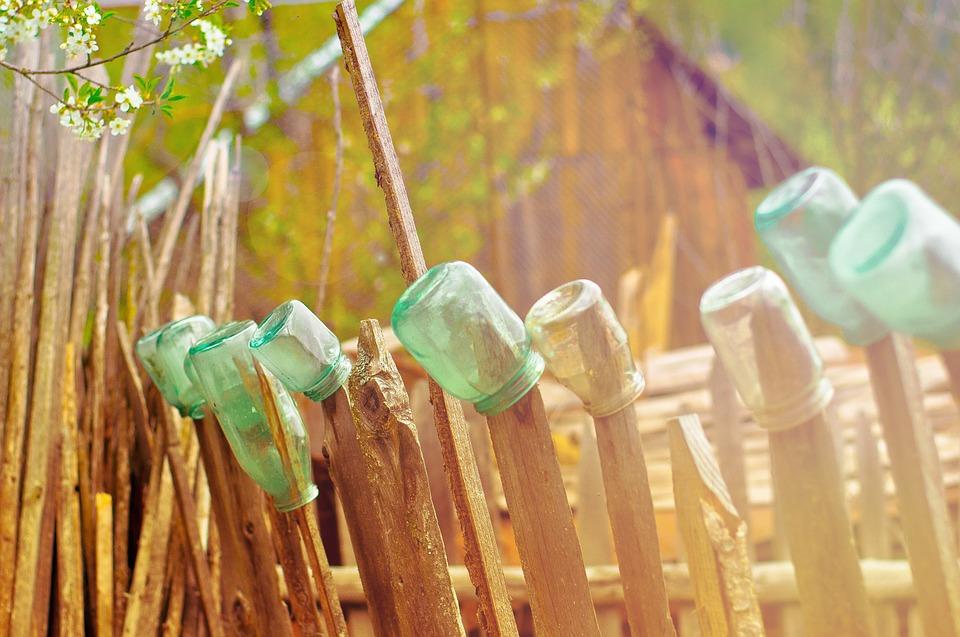 Glass jars on fence