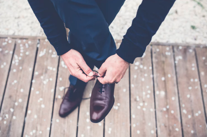 Man tying dress shoes