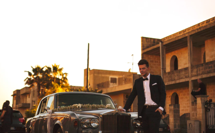 Groom with vintage car