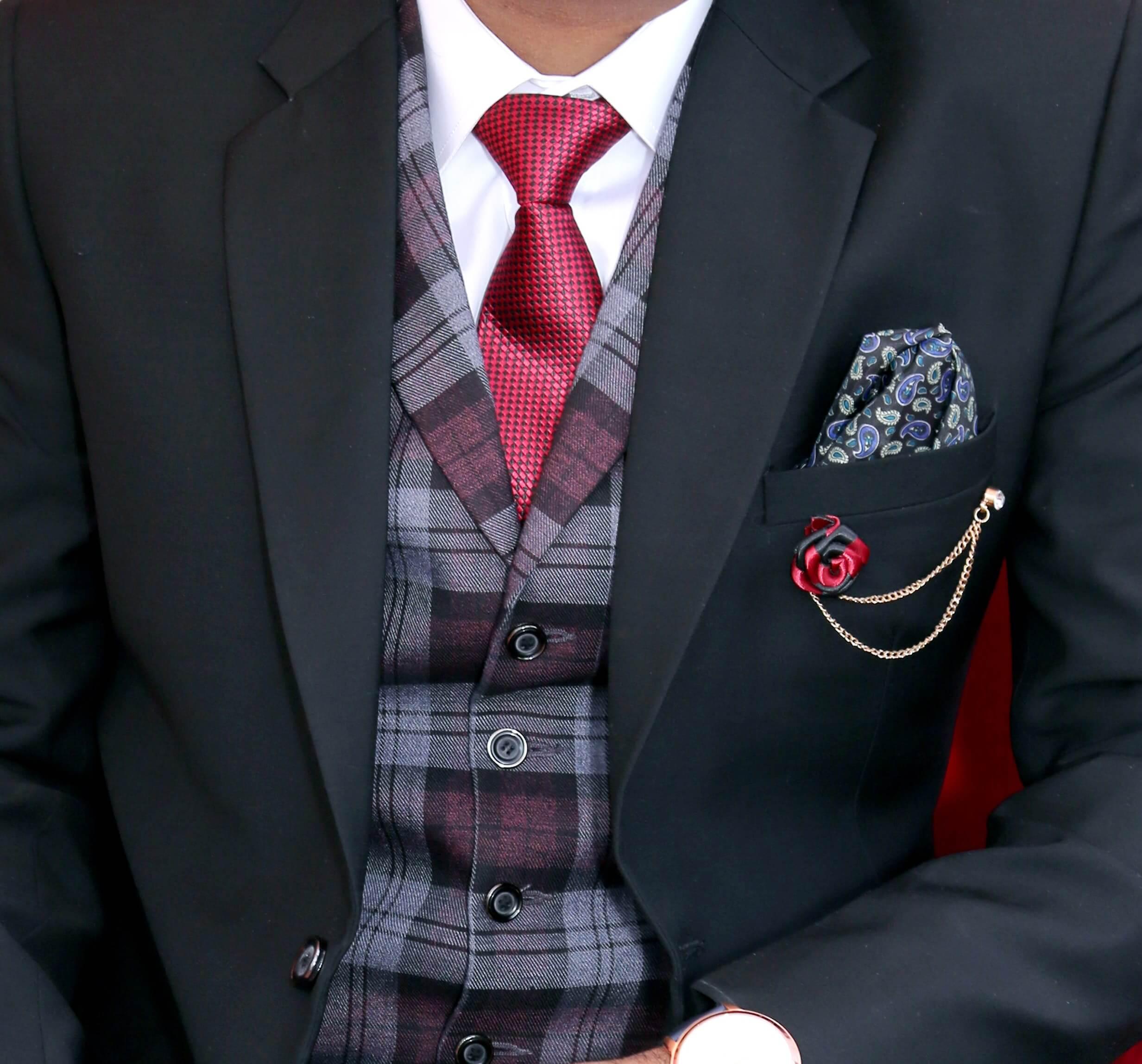 man in tuxedo with red tie