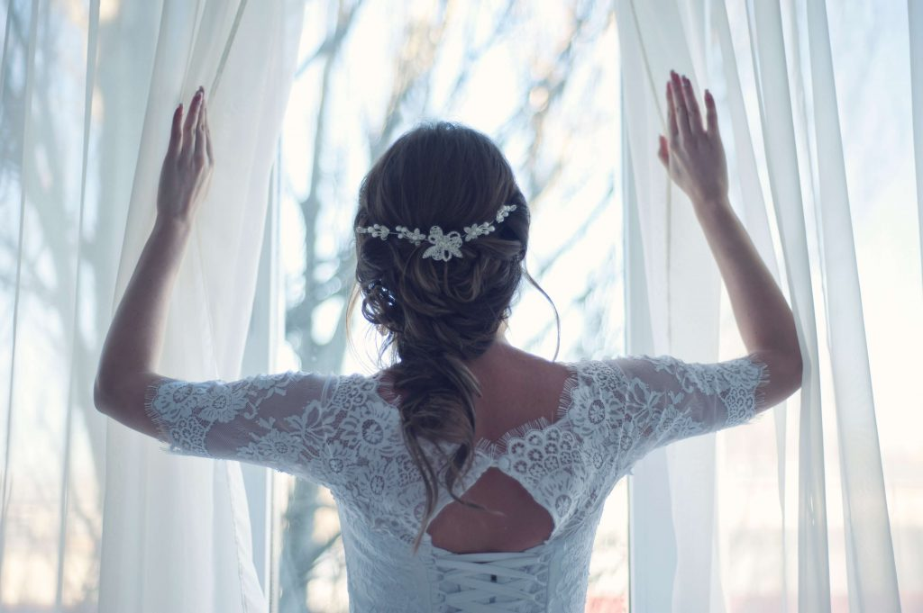 bride spreading the curtain