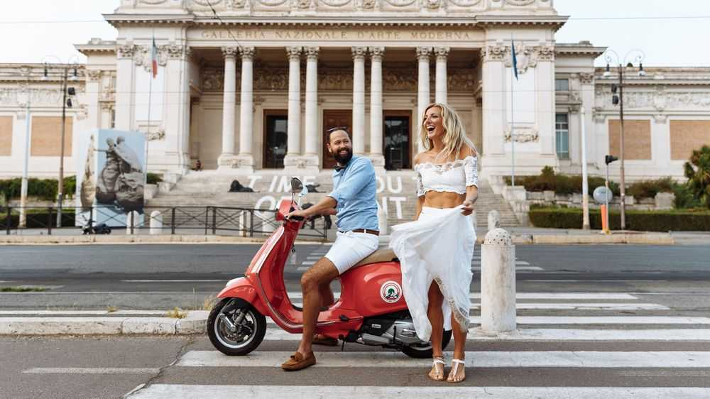 Smiling Couple with Vespa on the Crosswalk