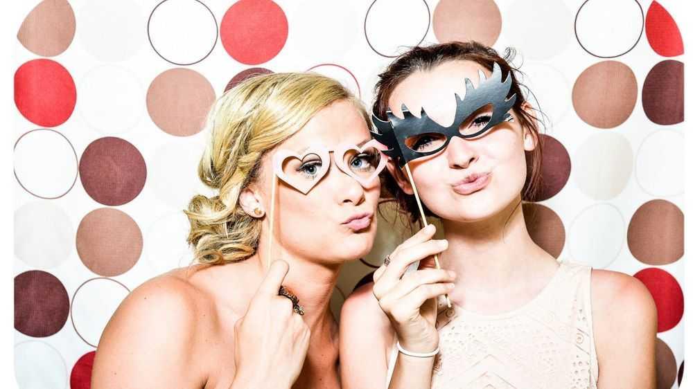 two beautiful girls wearing masks