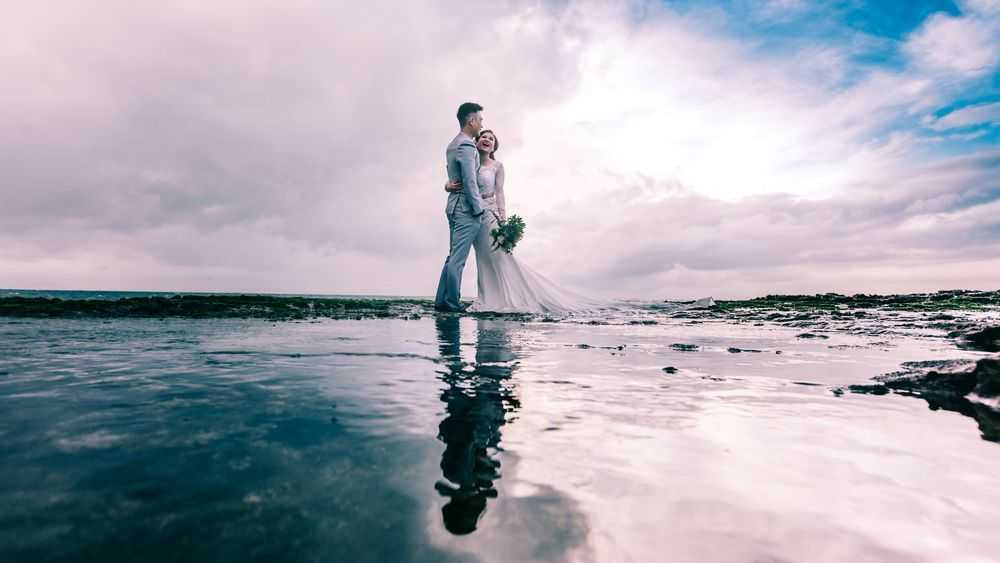 bride and groom on the coast
