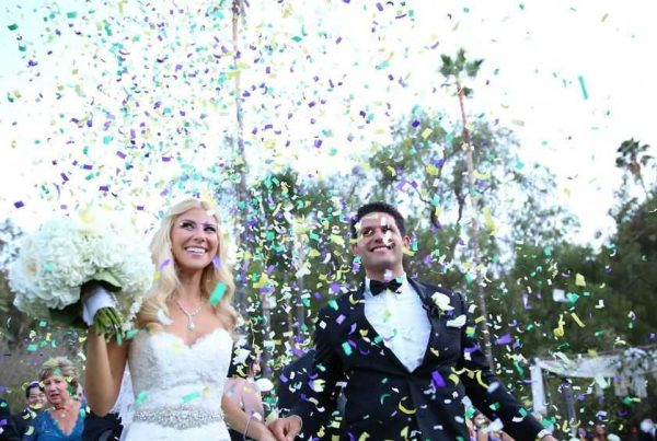 bride and groom in cloud of confetti