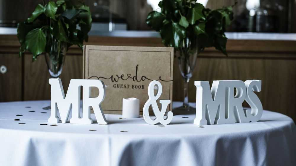 wedding table with letters and guestbook