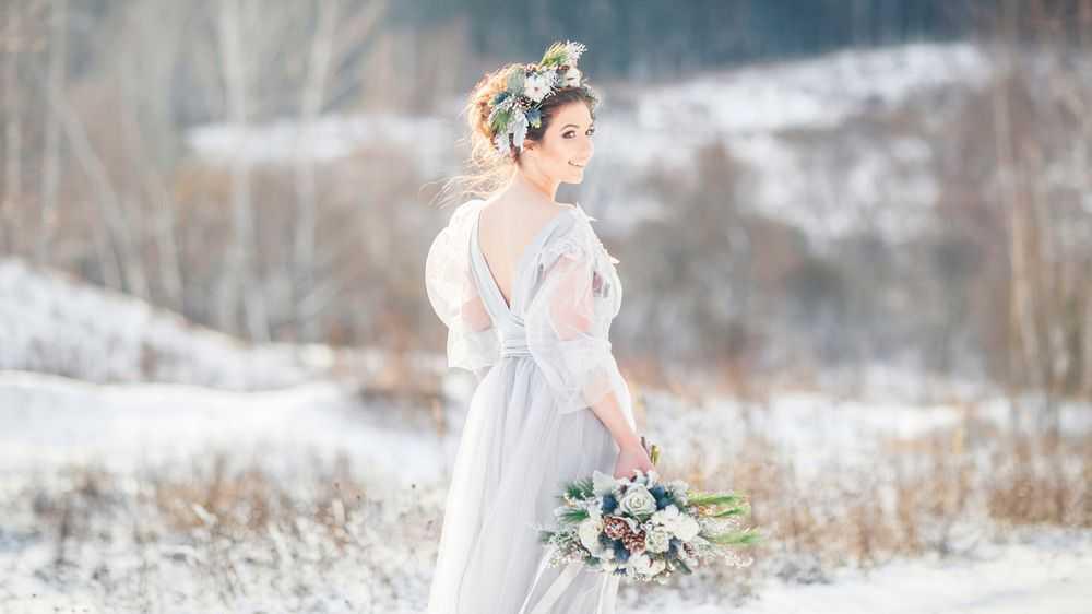 beautiful bride walking in the snow