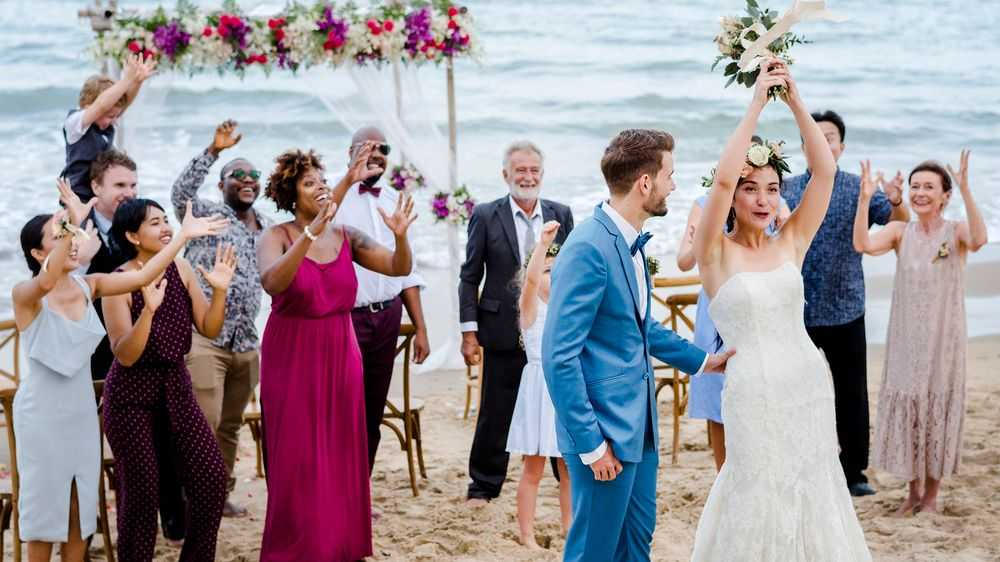 bride throws birdmayer beach wedding