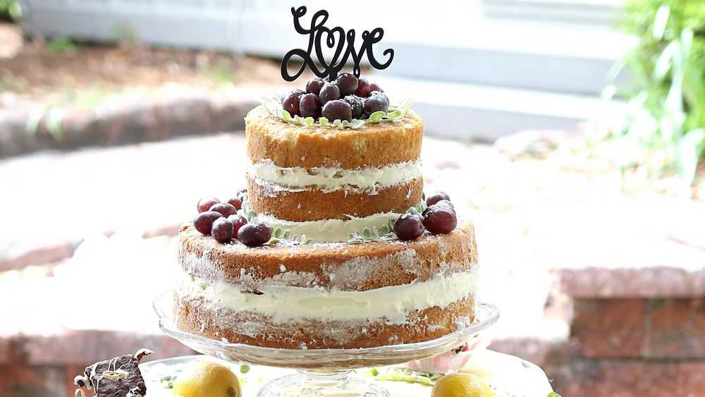 naked cake with chocolate decoration and grapes