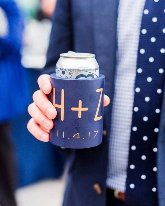 man holding can with koozie