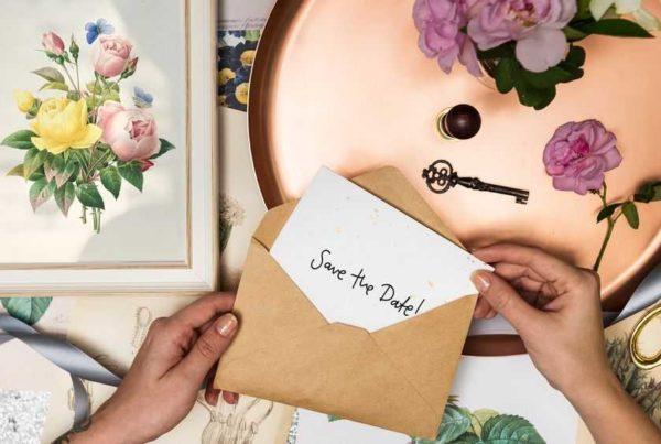 women hands put invitation in the envelope