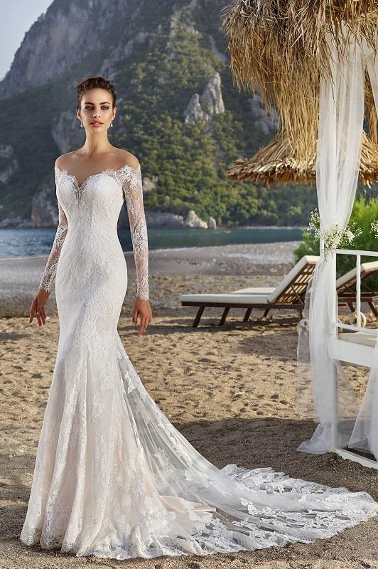 model in DressAfford mermaid long sleeve dress on beach