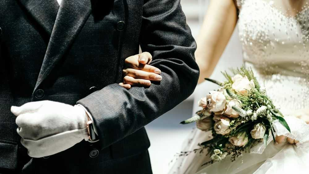 bride holds father's hand