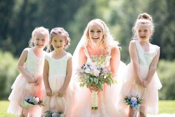 bride and three little girls in the garden