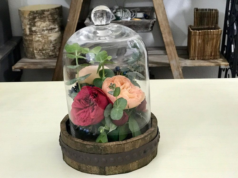 cloche with flowers