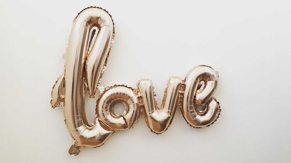 golden balloon sign love