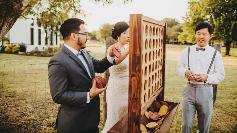 groom bride playing connect four