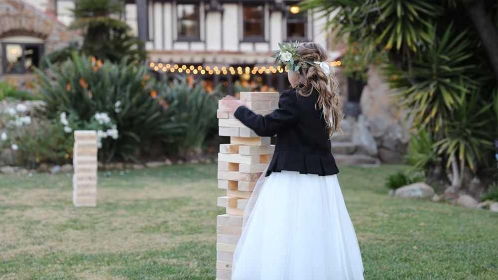 little girl plazing giant jenga