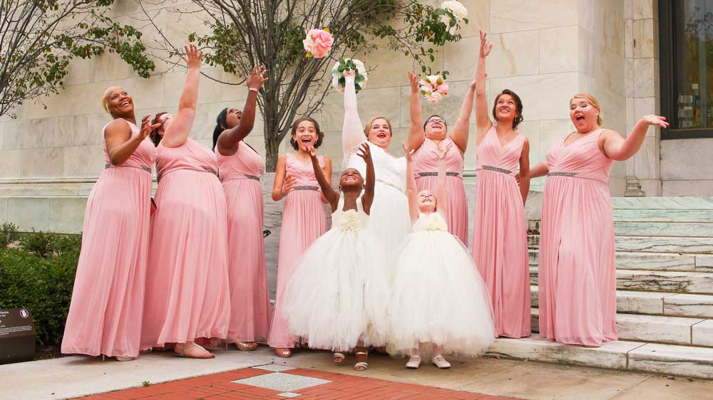 Bridesmaids throing flowers