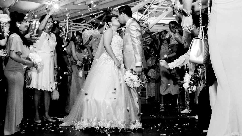Bride Kissing Groom in Wedding Hall
